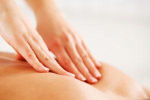 Close-up of a back massage.  White background.